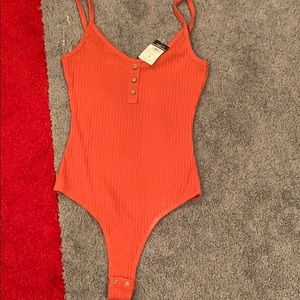 A small body suit.